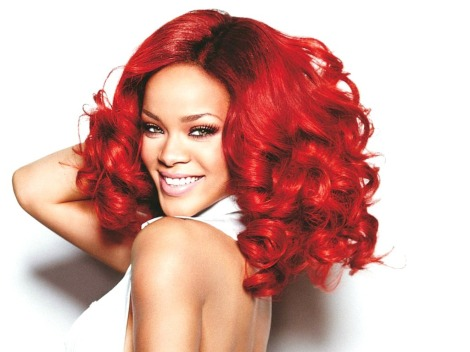 Rihanna with Red Bouncy Curlys and her huge Smile