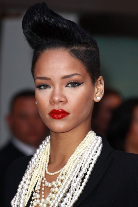 Love the hair, shaven on the sides. The Highlighting Make-up is a bit much. She does Red lips very well!