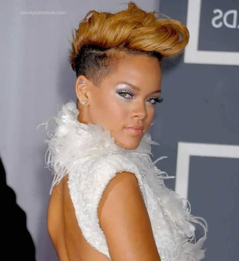 Rihanna and her shaved head with Blonde Updo Looking Fierce. The dress is Beautiful with the cut out back! Nice Colour